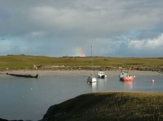 Hint of a rainbow over the Hebridean Isles