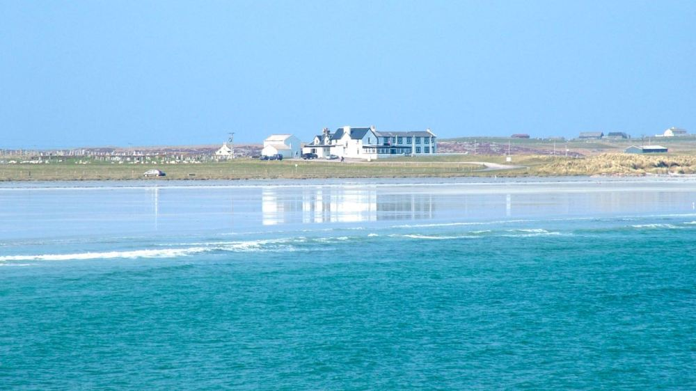 Tiree Lodge Hotel reflected on Gott Bay