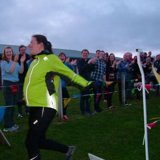 A mum to be crosses the finish