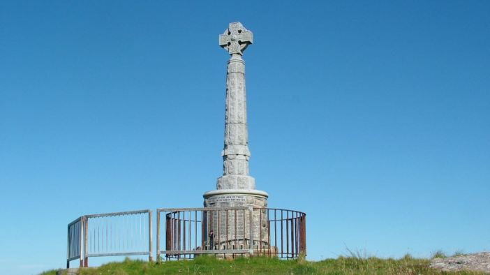 Close to Pier Road, the memorial stands out against clear blue skies