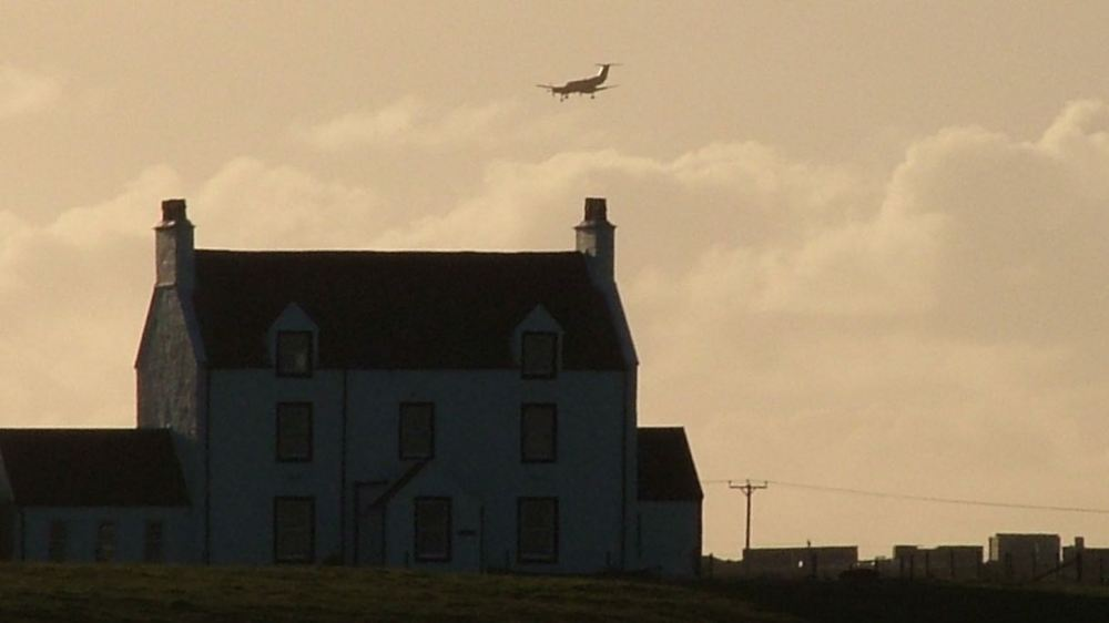 Air Ambulance makes its approach to Tiree Airport (passing behind Glebe House)