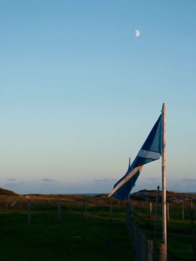 The risen Moon with the Saltire flying at Pier View and over the Passage of Tiree