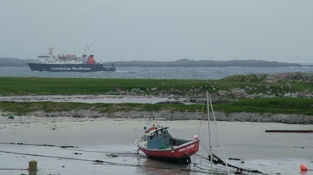 Lord of the Isles (background) and Scarinish Harbour (foreground)