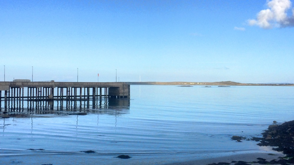 Low water reflecting the Pier structure