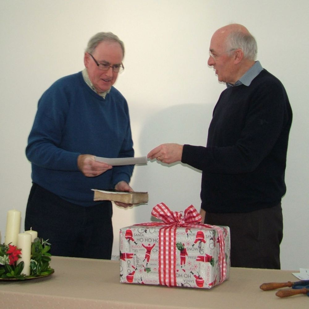 Ian Tainsh receives the church's gift from John Bottomley