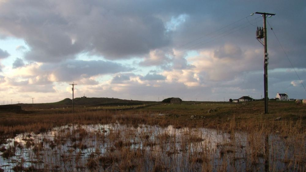 A tarn off Pier Road reflects the late afternoon sky
