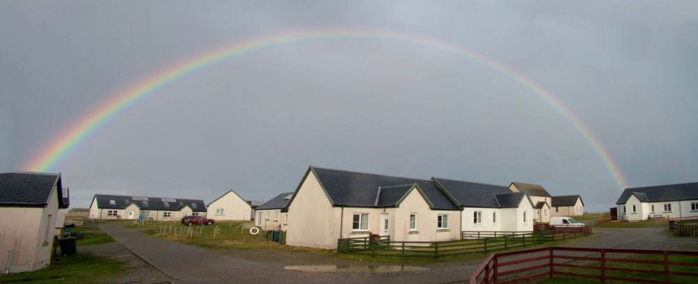 A rainbow briefly spans Pier View, Scarinish
