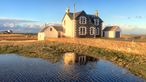 Reflecting in the late afternoon sunshine. Pier Road, Scarinish
