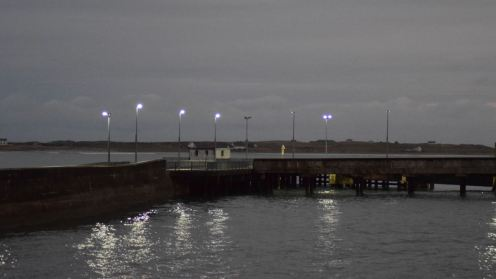 Lights reflecting as we wait the arrival of MV Hebrides