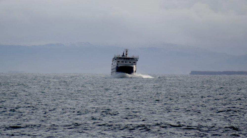 The MV Hebrides enter Gott Bay