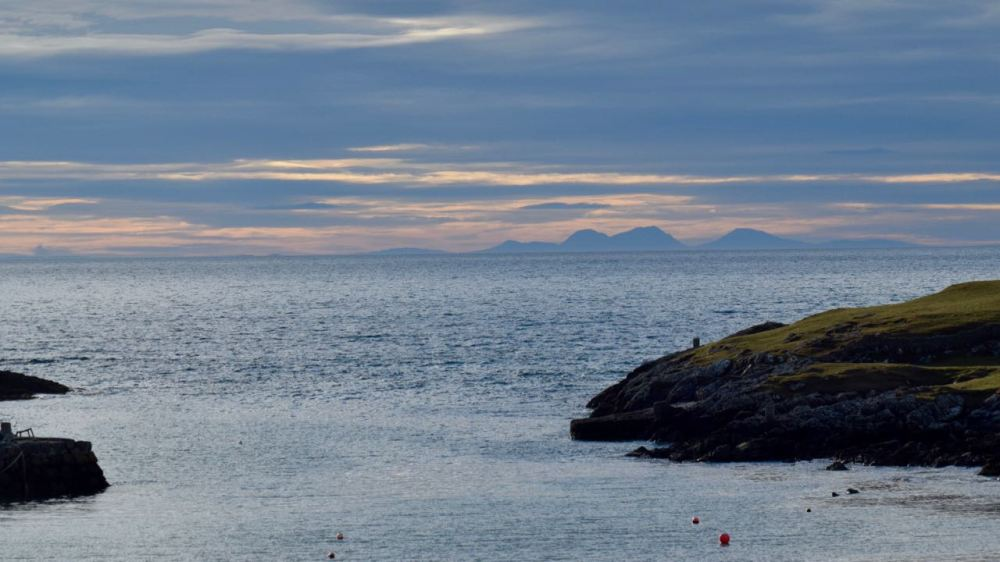 Looking beyond Colonsay to the Paps of Jura