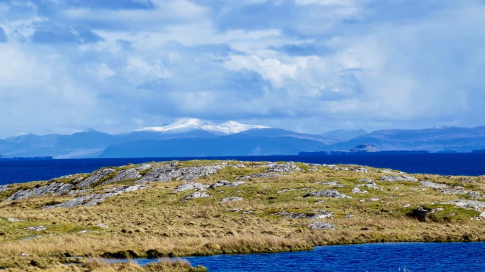The view across to Ben More on Mull and the Dutchman's Cap