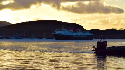 The MV Isle of Mull against the setting sun