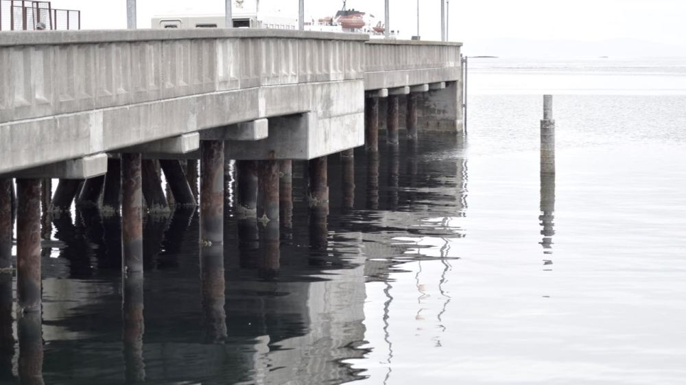The pier reflected in the still waters
