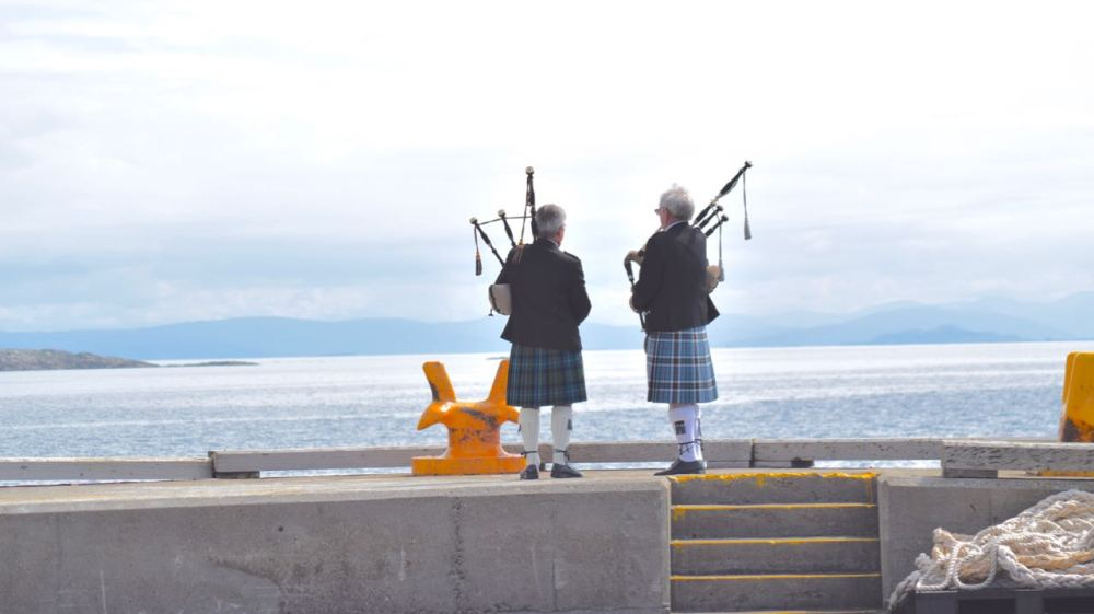 Two Pipers pipe farewell to those leaving by ferry