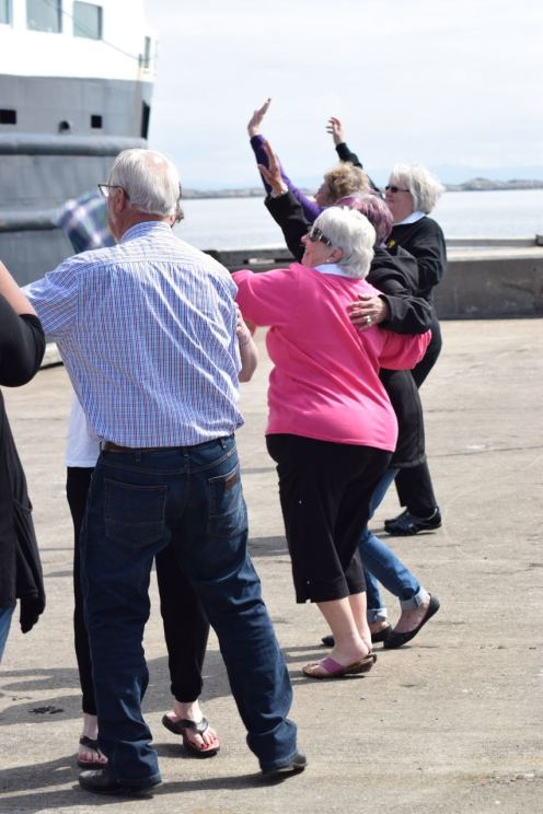 Dancing and waving on the pier
