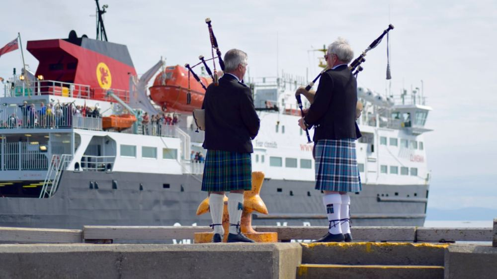 The pipers play as the Clansman heads out to sea