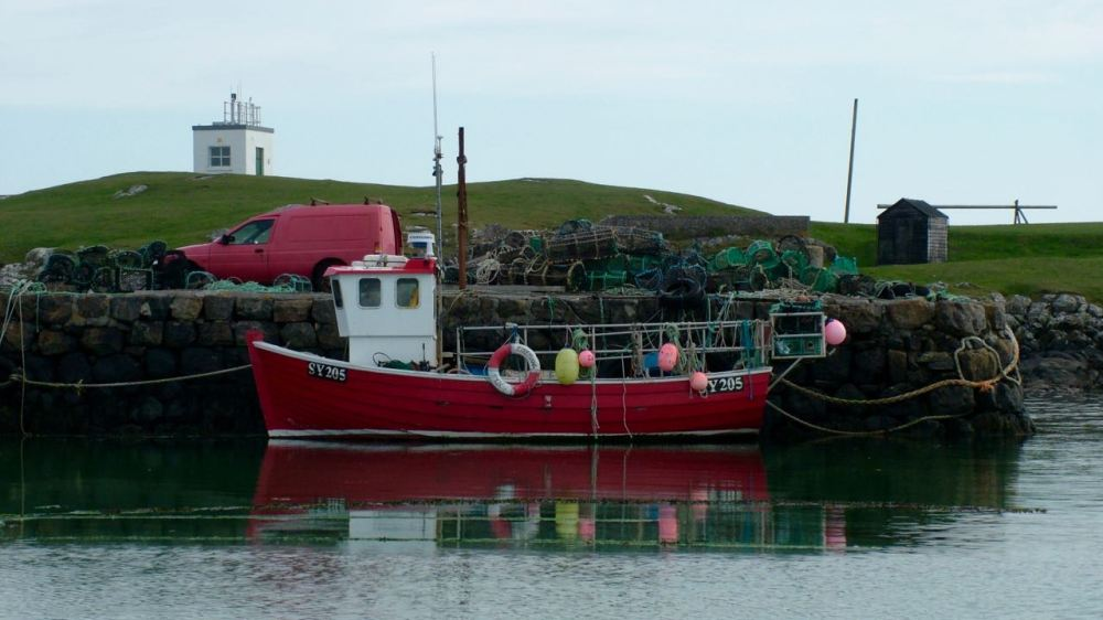Reflecting on calm waters at Scarinish harbour