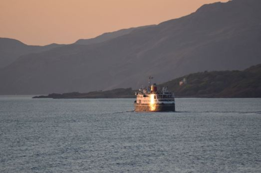 Reflecting the setting sun the Hebridean Princess heads north up the Sound of Mull