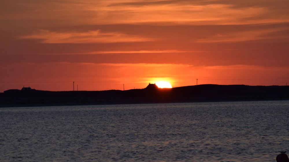 A tantalising sunset over Gott Bay