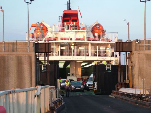 Vehicles proceeding up the linkspan