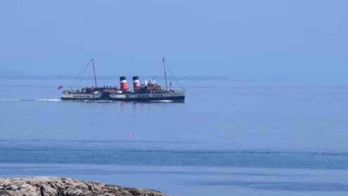 PS Waverley leaving the Gunna Sound and returning to Scarinish