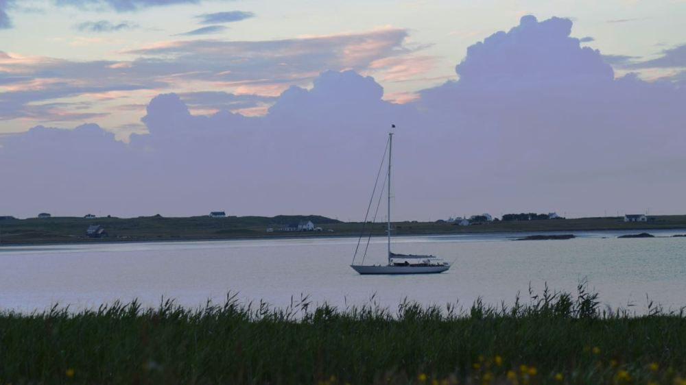 A poor hint of sunset over Gott Bay captured from Pier Road