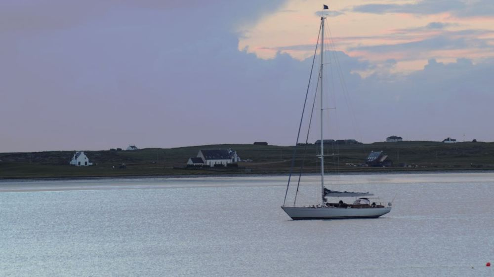 Another view of the visiting  yacht at anchor in the bay.
