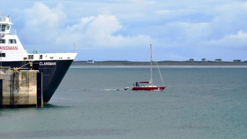 A yacht passes the MV Clansman