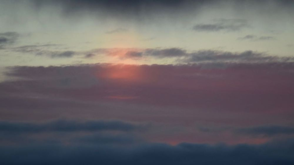 The sun had set yet there is a distinct red spot in the clouds