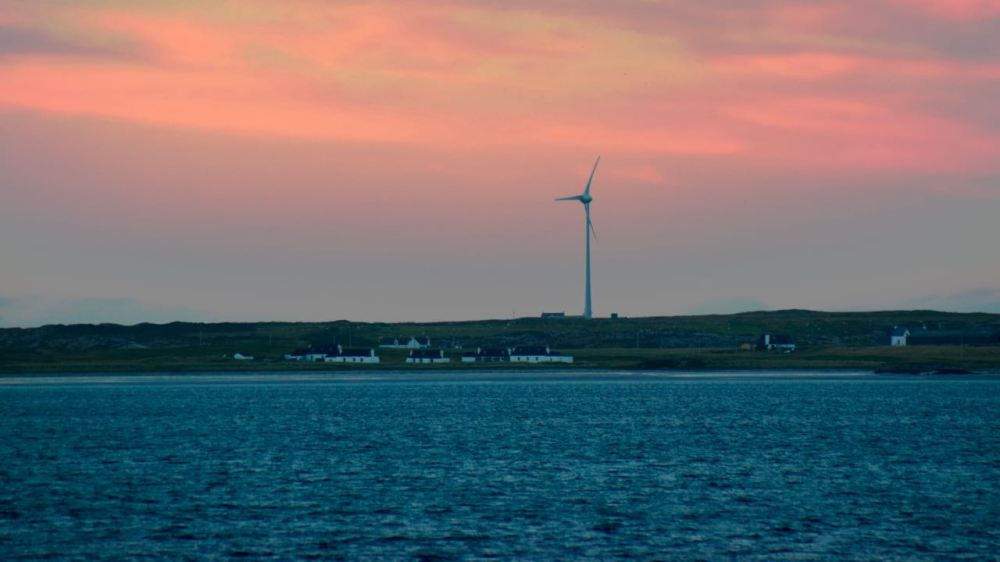 To the North East, Tiree's Turbine Tilley against a red sky