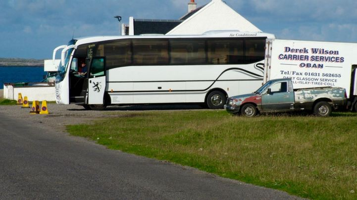 Coaches await the arrival of the ferry