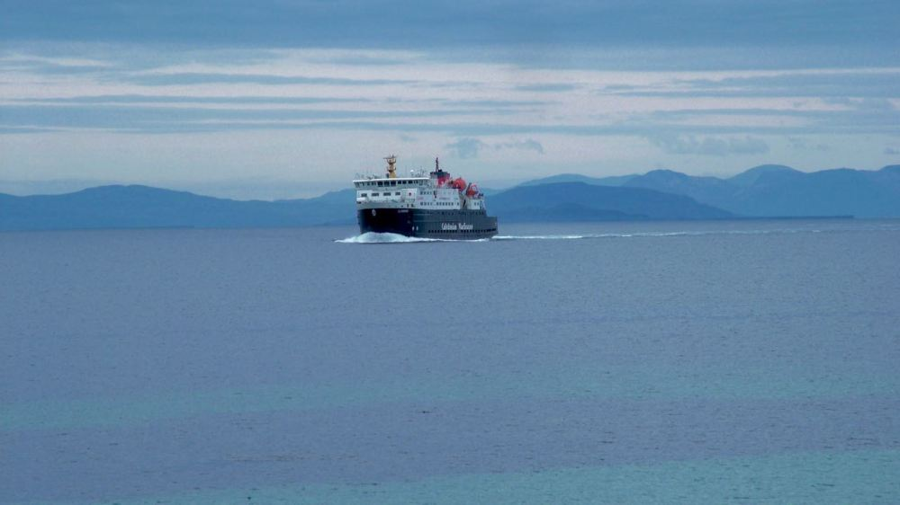 The MV Clansman against a background of the Isle of Mull and Treshnish Isles