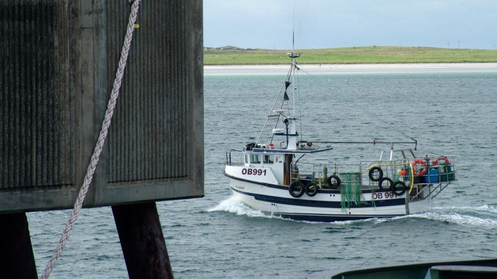 The fishing boat arrives back in Gott Bay