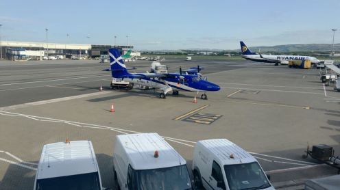 A Tiree bound Twin Otter waiting boarding at Glasgow International Airport