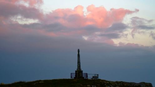 Storm clouds over Tiree's memorial.