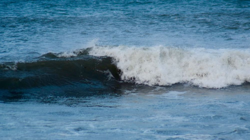 Waves power in to Gott Bay