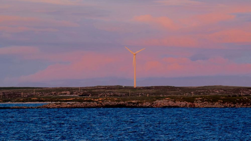 Telly, Tiree's Turbine, transformed by the sunset