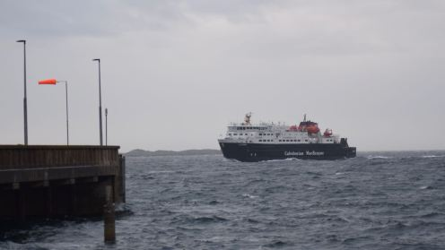MV Clansman approaches the pier in strong winds