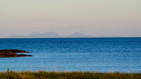 The Paps of Jura from Baugh as the sun goes down