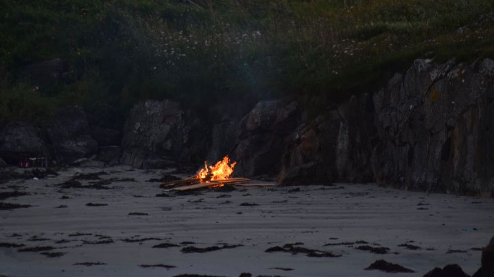 A fire on the beach by the Pier Office