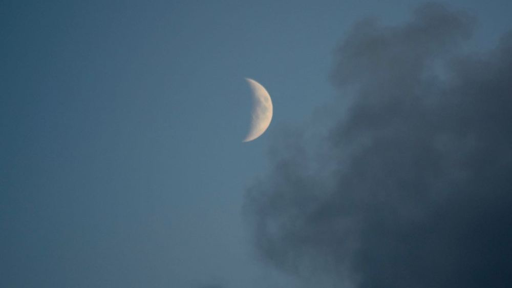 The Moon high in the western sky