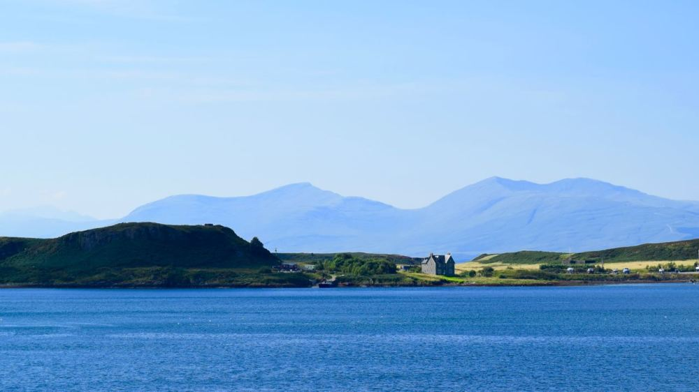 Looking across the bay to the island island of Kerrera to distant peaks