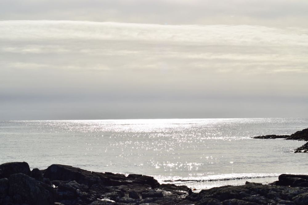 Sun streaming across the waters of the Passage of Tiree.