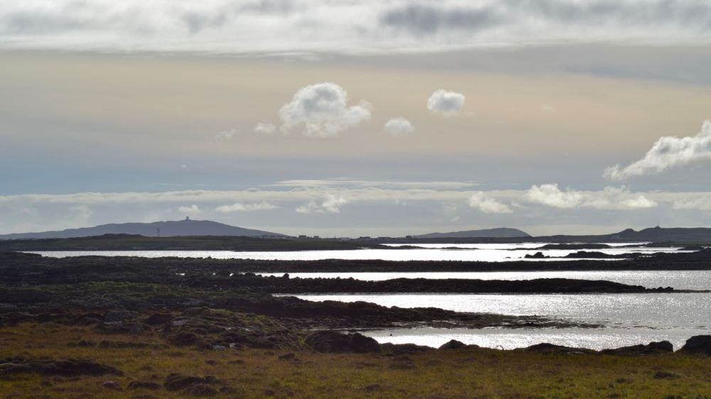 Looking from Milton towards Tiree's three Bigs Bens