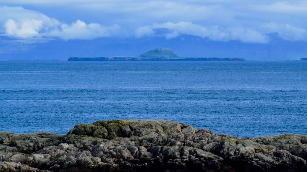 They view across the Passage of Tiree to the Treshnish Islands and Mull