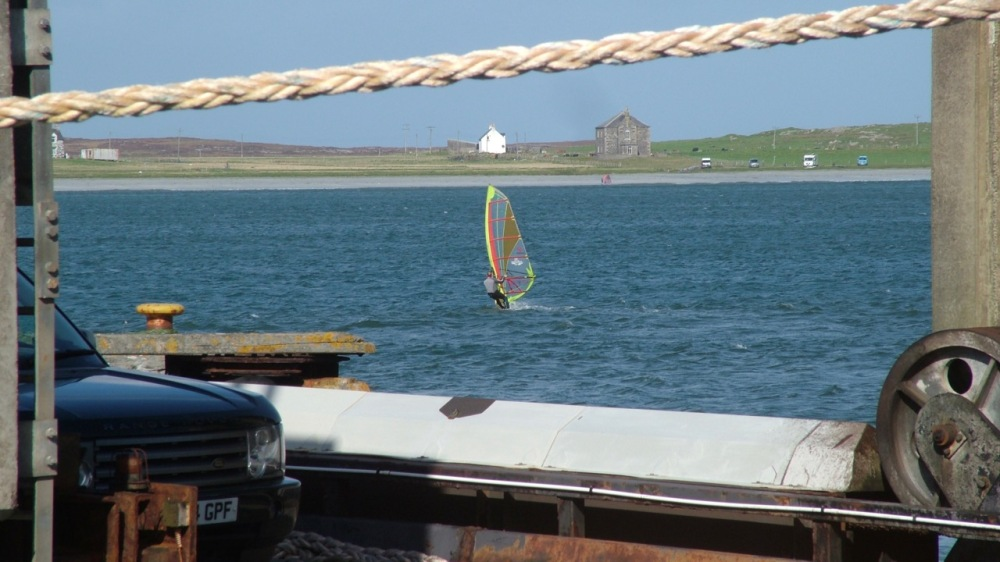 Surfing in Gott Bay - looking across the linkspan at the pier