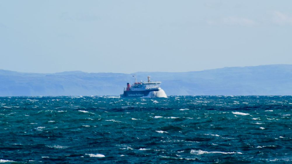 Thursday and the MV Lord of the Isles out in the Passage of Tiree