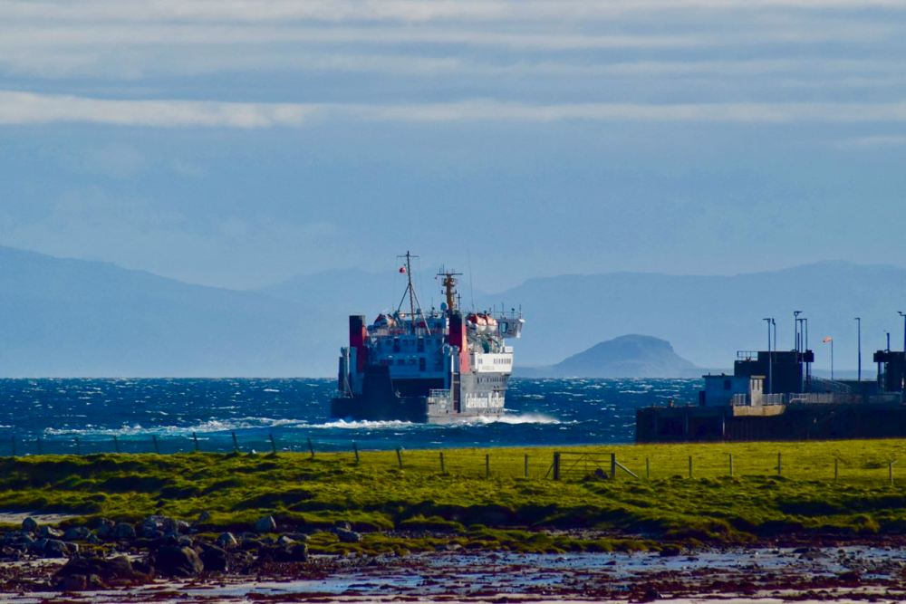 The MV Lord of the Isles thrusts away from Tiree's pier en route for Barra