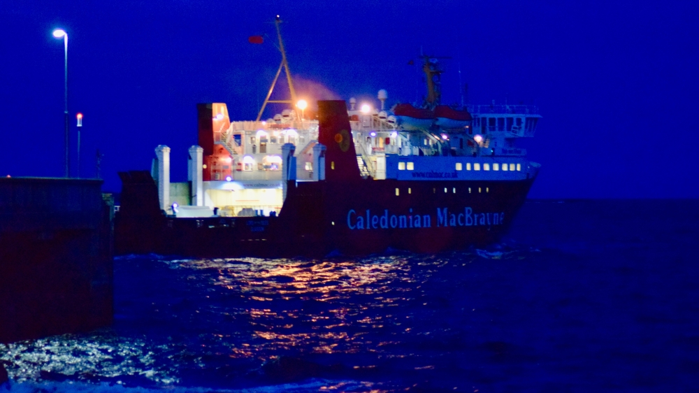 MV Lord of the Isles thrusts away from Tiree's floodlit pier